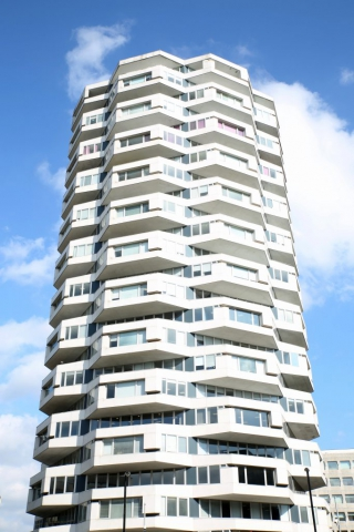 I took this shot of the 50p shape building in Croydon CRO 0XT formerly NLA designed by Richard Seifert. By Dpi Photography.