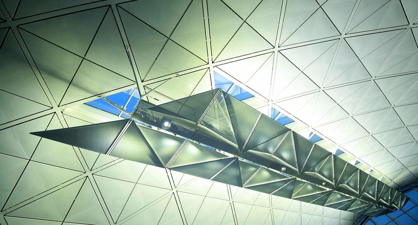 This shot was taken at Hong Kong airport of the roof structure whilst waiting for our connection. By Dpi Photography.