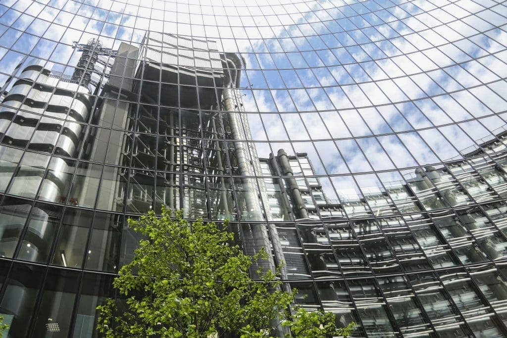 This is a reflection of the Lloyds building in the Willis Building in the City of London.  By Dpi Photography.